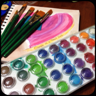 Watercolors, paintbrushes and Art Journal