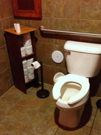 toilet with stacks of toilet paper