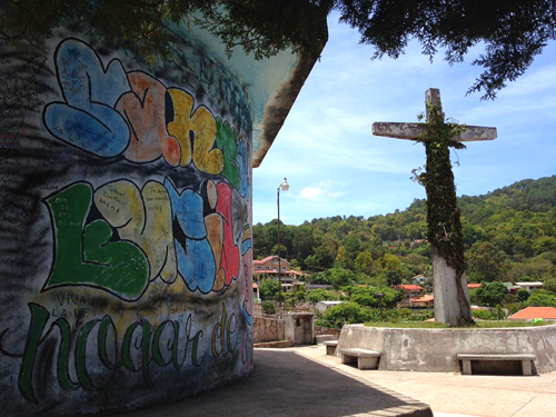 Cross and graffiti in Santa Lucia, Honduras