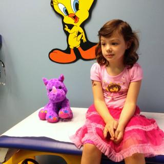 a girl and her stuffed purple rhino