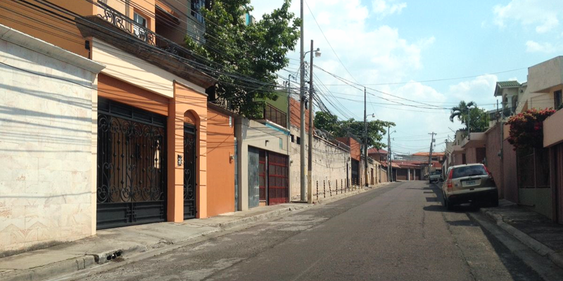 Street lined with walls in a Tegucigalpa, Honduras, neighborhood.